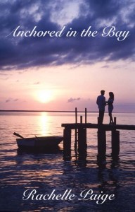 romantic couple on dock with row boat at sunset/sunrise
